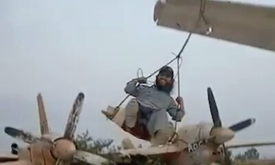 Taliban fighters swinging with wings of Airplane in Kabul